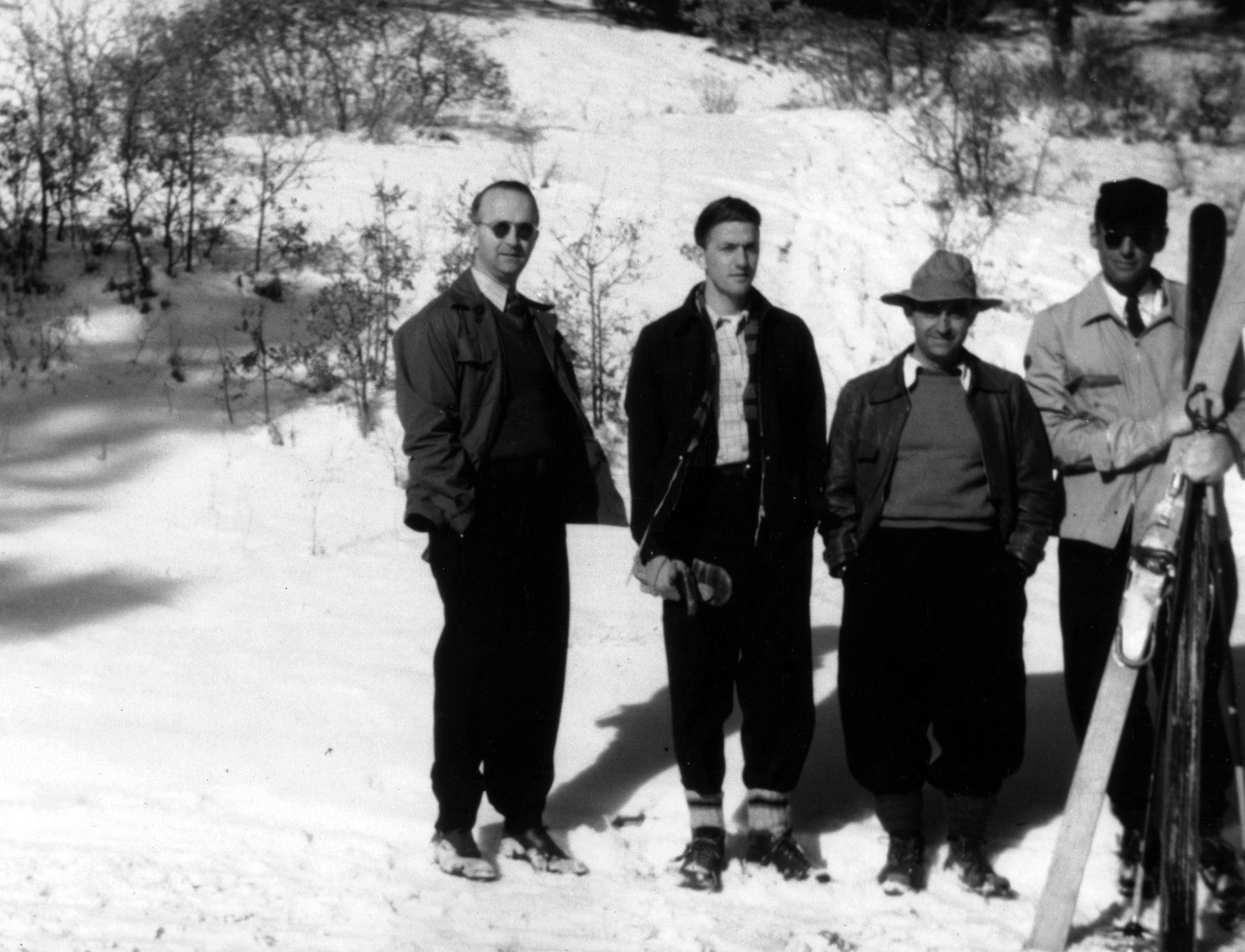 Enrico Fermi and colleagues skiiing. Photo courtesy of Los Alamos National Laboratory.