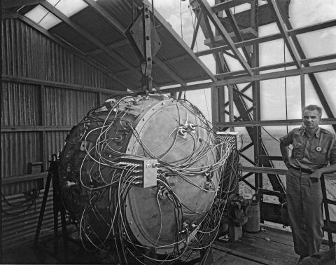 Norris Bradbury standing next to the Gadget Device. Each of the 32 detonators (circles with two wires) attached to the Fireset (box) using two bridgewires.