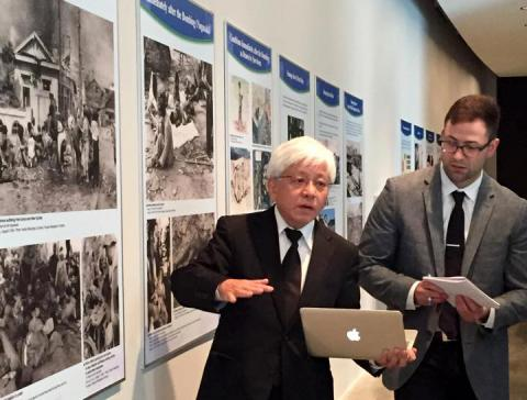 Dr. Kenji Shiga and his translator at the AU exhibition