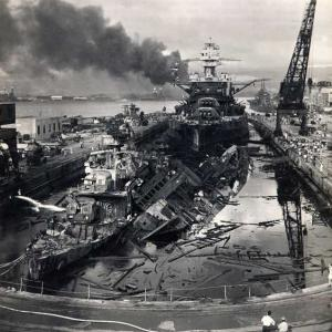 USS Pennsylvania, behind the wreckage of the USS Downes and USS Cassin