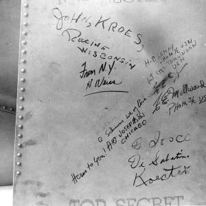 """Signatures on Fat Man's tail assembly. You can see the small signature of """"W. S. Parsons, USN"""" or Enola Gay weaponeer Deak Parsons, to the far left"""