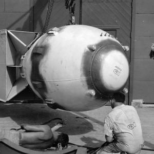 """The sealant has been applied. Note the signatures on the tail assembly and the """"bomb"""" on the worker's shirt"""