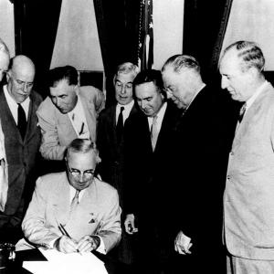 President Truman signs the Atomic Energy Act into law on August 1, 1946.