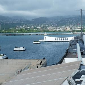 The USS Arizona Memorial and Honolulu as seen from the deck of the USS Missouri.