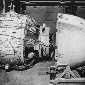 """Fat Man Assembly - X Unit visible on right of sphere attached to """"B"""" plate on the forward aluminum cone"""