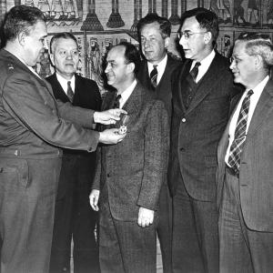 General Groves pinning an award on Enrico Fermi