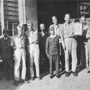 The Nagasaki survey team, including Japanese interpreters and guides
