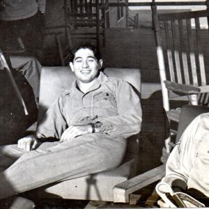 """""""William S. Ginell (smiling), taken on the porch of our dormitory with my camera. On right is Joe Silverman."""" Photo Courtesy of William S. Ginell"""