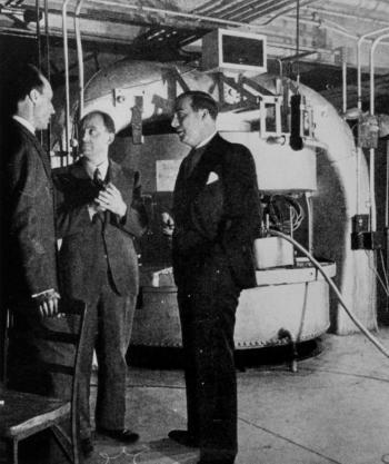 Mitchell (left) with Fermi and Dunning.