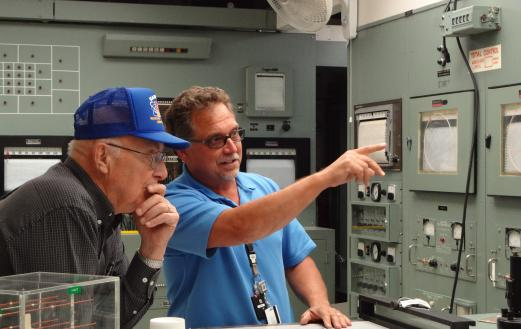 Kirk Christensen, Manager, B Reactor Preservation Project, with BRMA member Del Ballard in the control room.